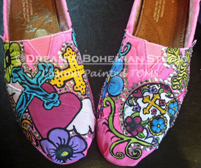 hot pink toms with bright colored skulls crosses and flowers