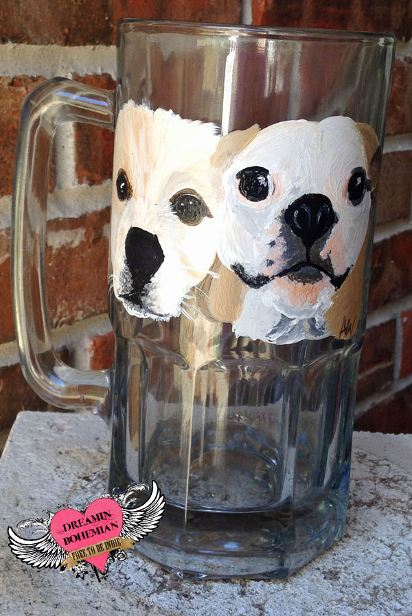two dogs painted on beer stein