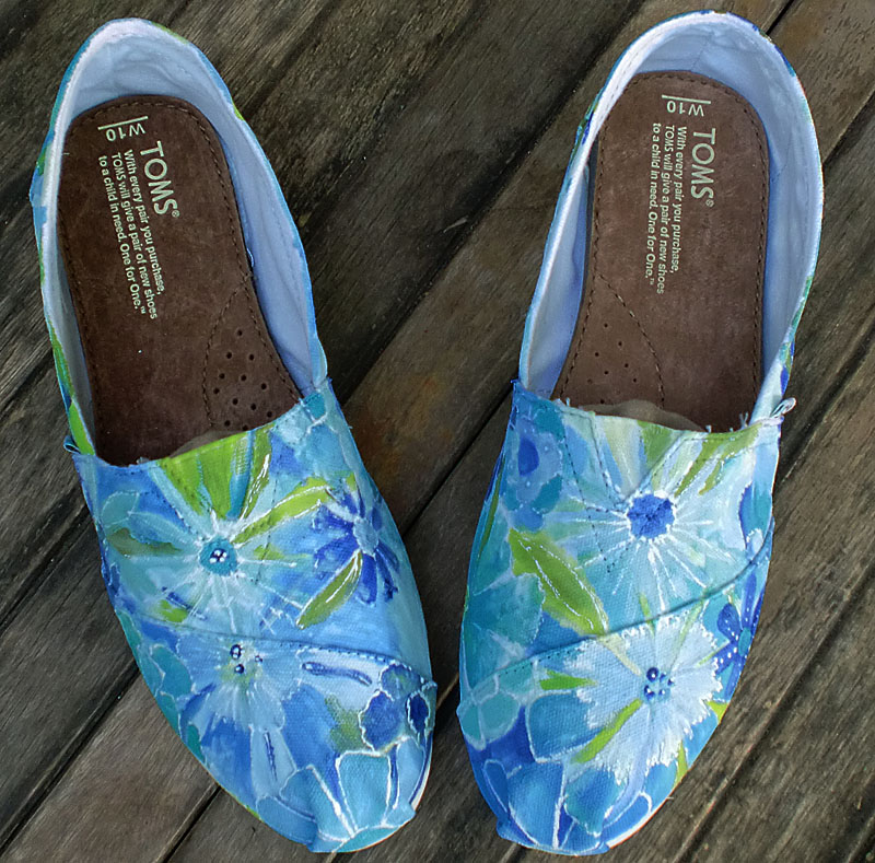 fields of blue flowers painted on TOMS